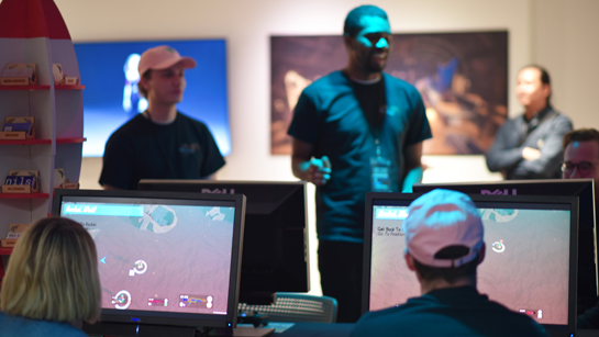 Students demonstrate and play video games at the Champlain Game Studio Senior Show