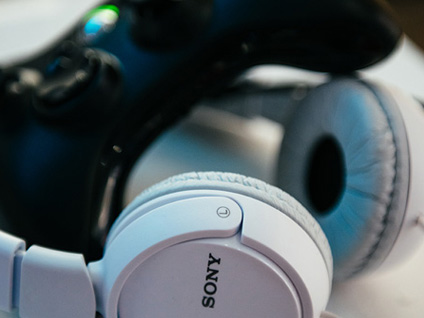 A photo of headphones and a game controller.