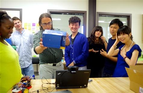 Professor Al Larsen demonstrating Ming Hu's software, digital bongo drums activated by the color blue.