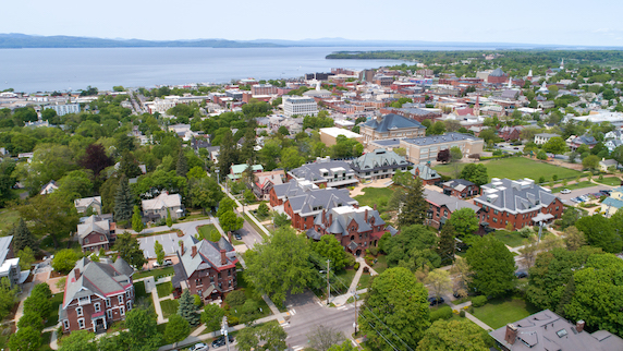 An aerial view of Champlain College with the shoreline in the distance