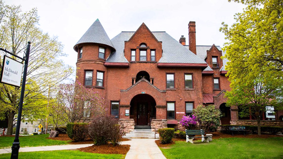 Front view of MacDonald Hall, a Victorian-era mansion residence hall