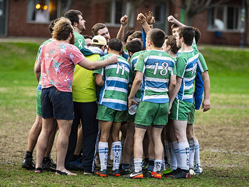 Rugby players in a team huddle