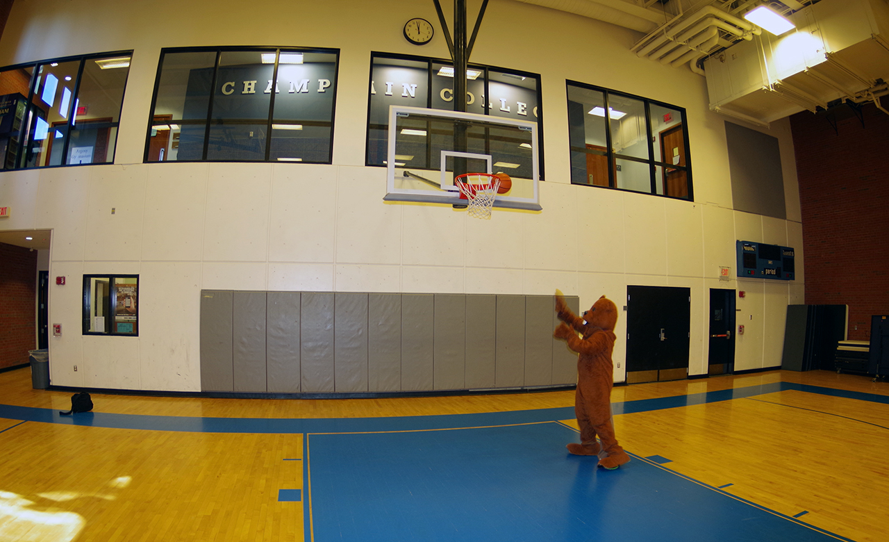 Chauncey play basketball in the gym