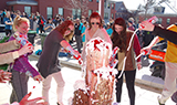 Champlain College students making a giant ice cream sundae at Spring Meltdown