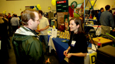 an employer talking to a man at the Champlain College career fair