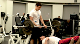 two students in the Champlain College fitness center