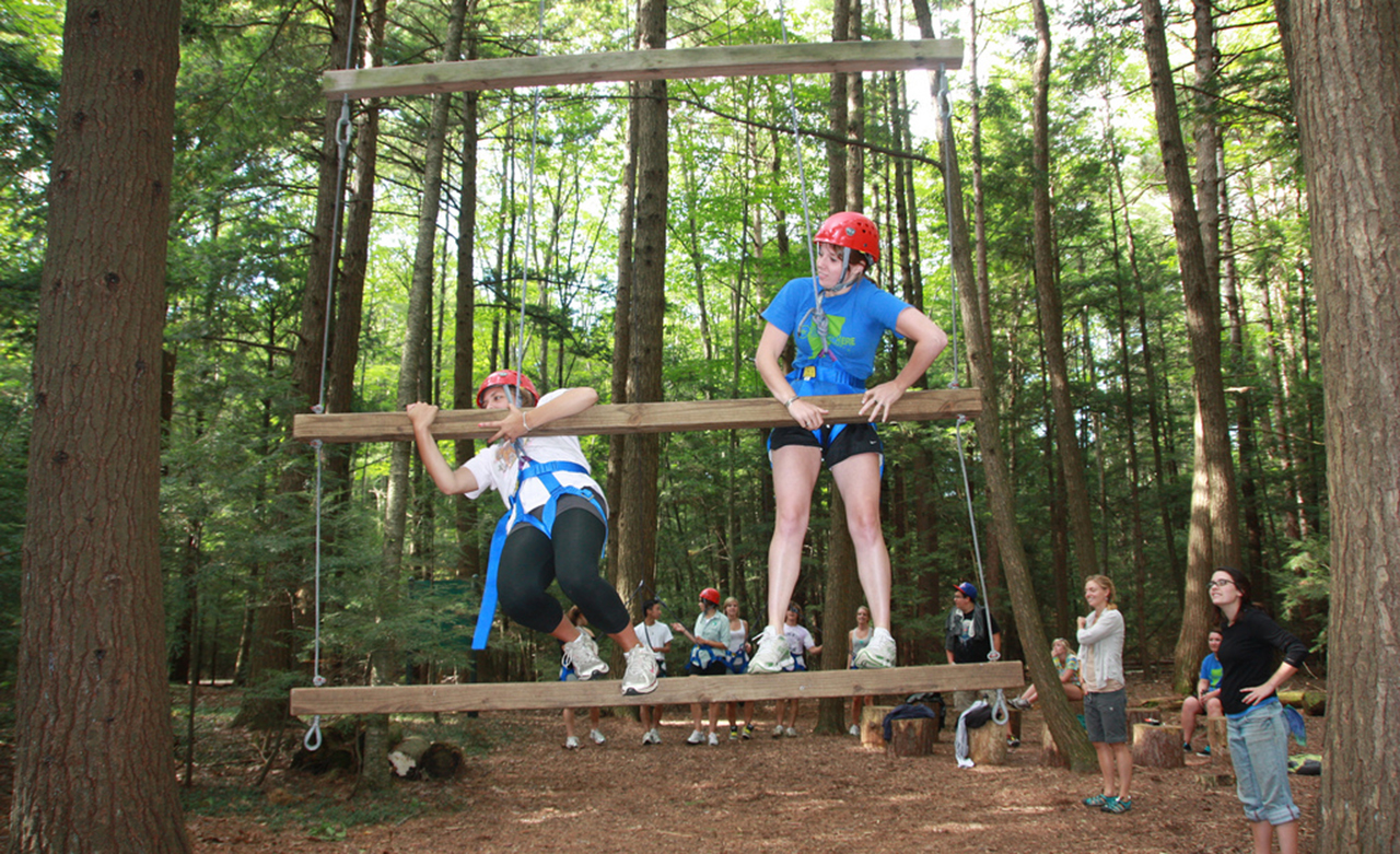 students on ropes course for teambuilding