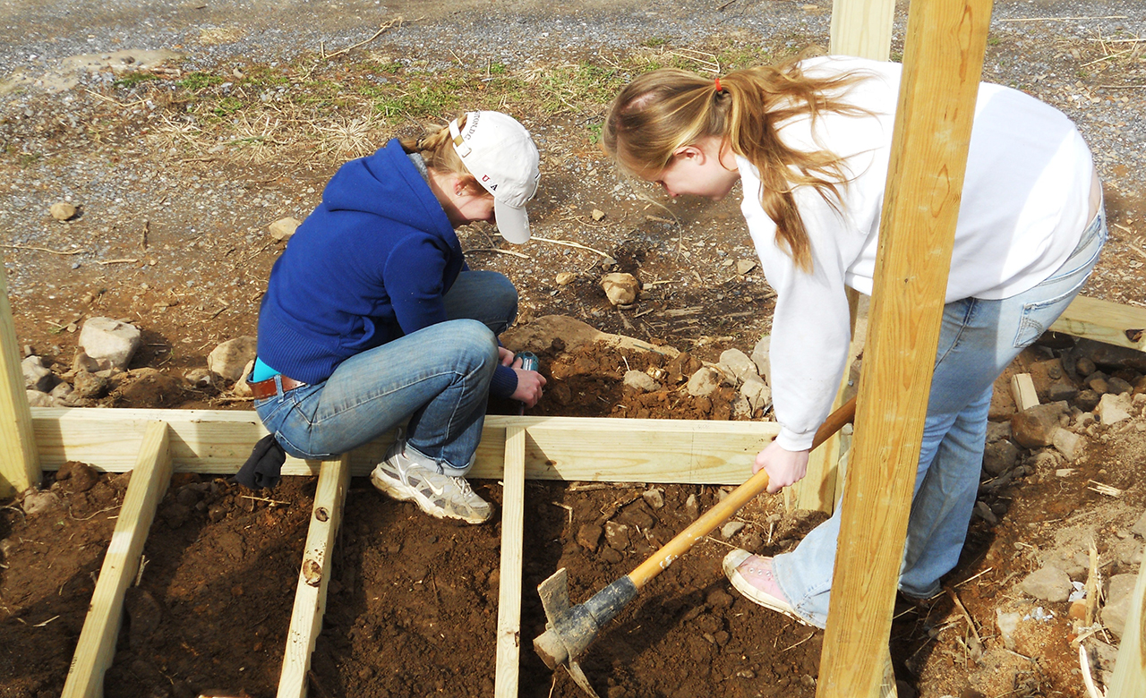 Champlain College students building on a volunteer trip