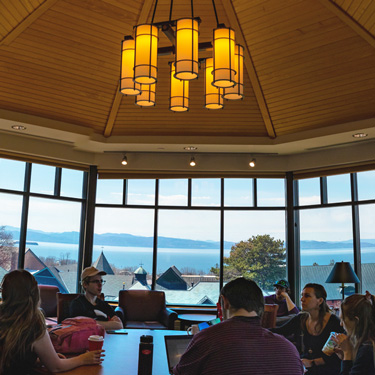 Students collaborating in a study group in Champlain's Vista Room in the library