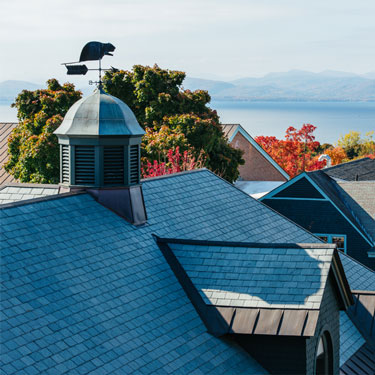 View of roofs and Lake Champlain in the distance