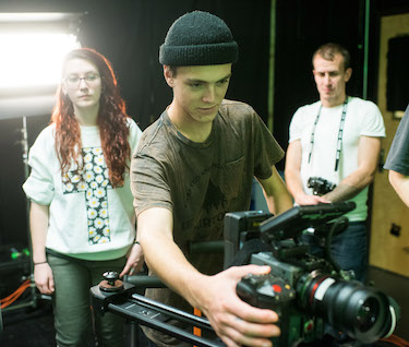 Filmmaking students interning on a shoot for Driven Studios