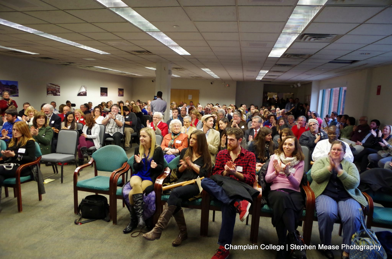 Family and friends gather in Champlain's Hauke Conference Room for the December Graduation