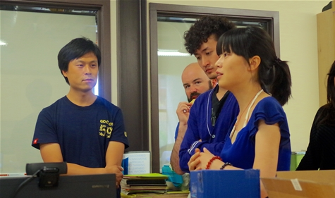 "Ming Hu, ZiChen ""Jin"" Liu, and Kang ""Kiki"" Jing during a Puzzles and Prototypes class in the Champlain College MakerLab."