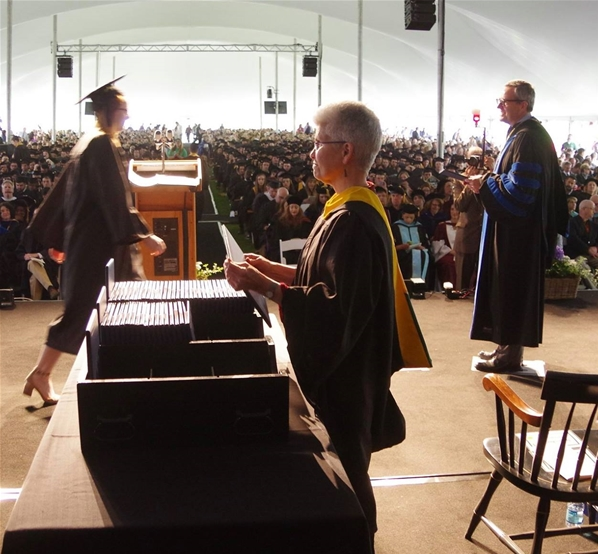 President Laackman presents diplomas to the Class of 2017