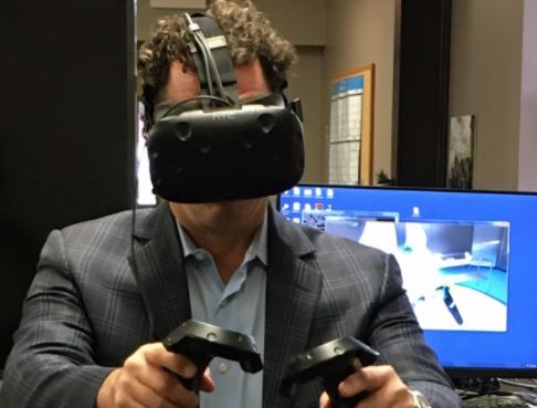 Dr. Bryan Huber tries the VR system at the EMC.