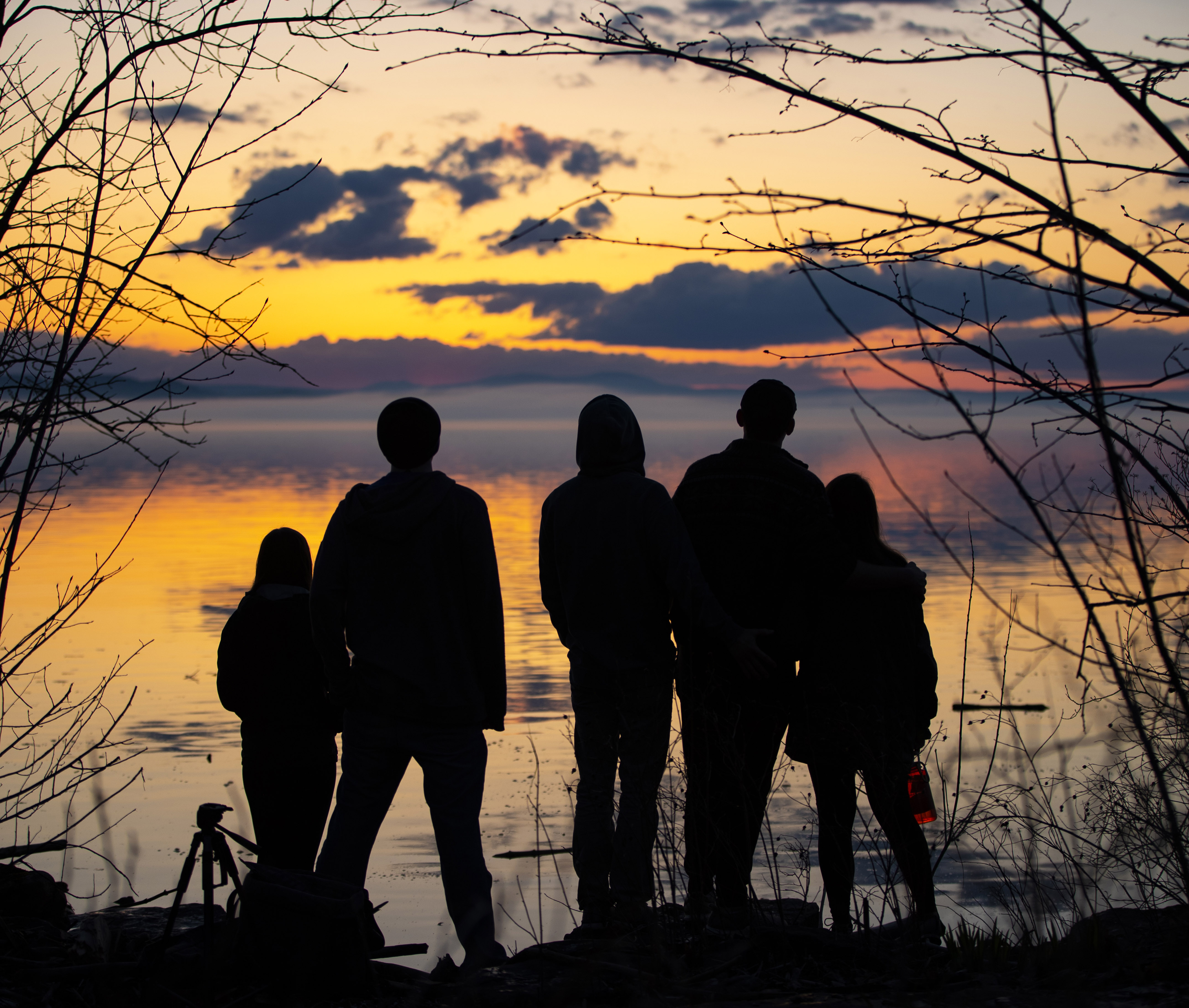 Students watching the sunset at Oakledge Park in Burlington, Vermont