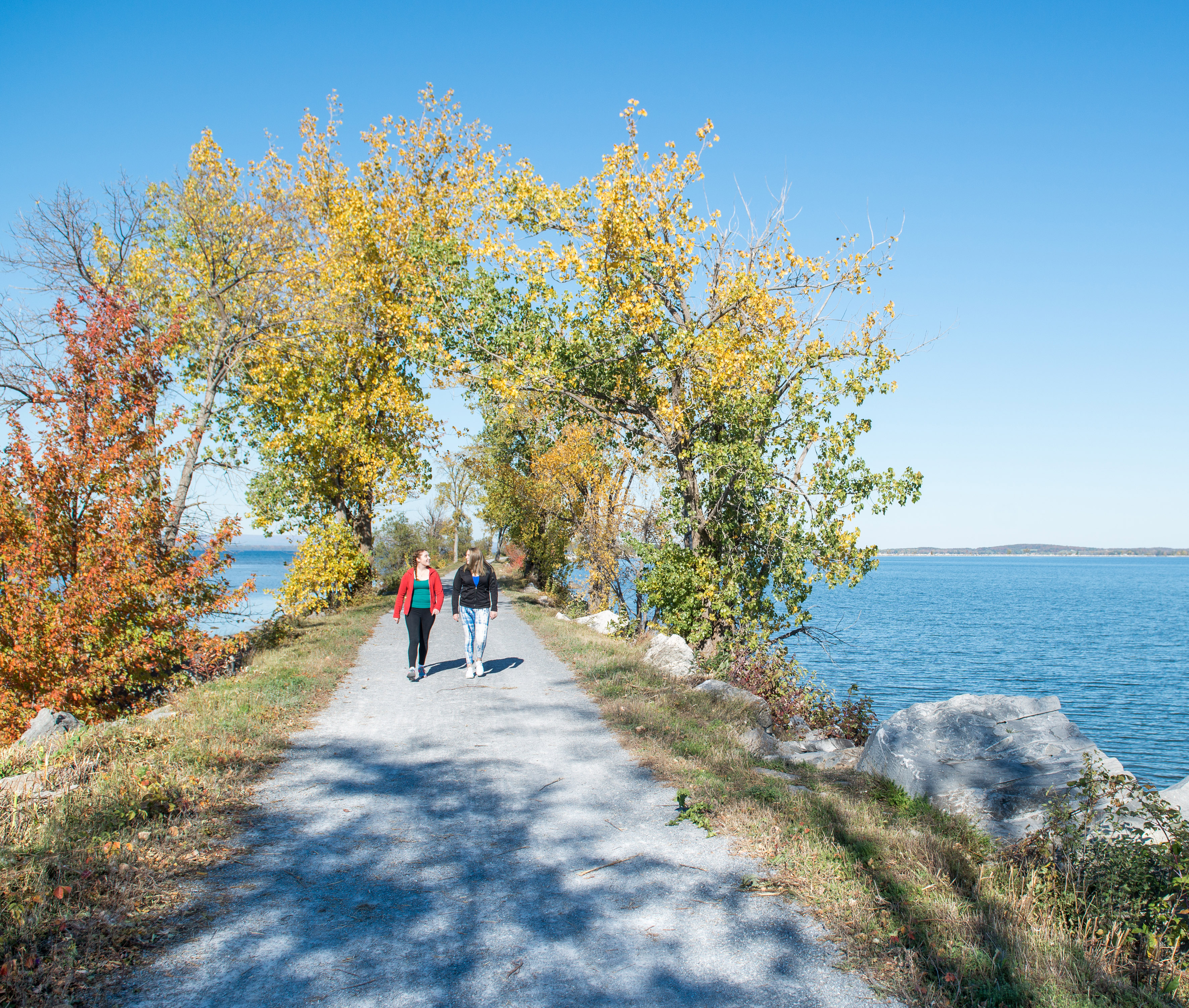 Students walking along the Burlington Bike Path, with Lake Champlain on both sides