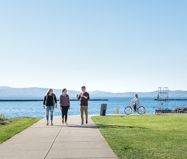 Students walking by the waterfront of Burlington, Vermont on a sunny day.