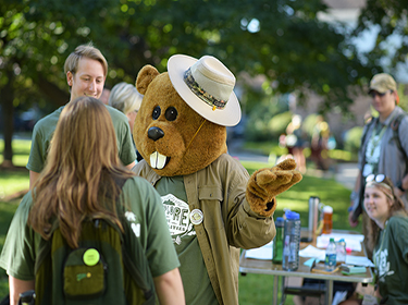 Champlain College mascot Chauncey talking with students on move in day